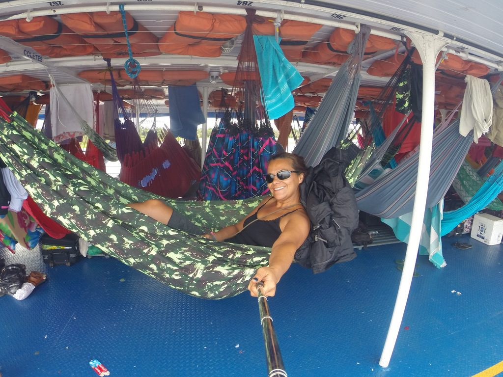 travel in amazon river by boat with hammock solo women